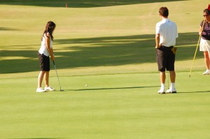 Losing to their cross-town rivals 262-251 at Rio Hondo Golf Course Oct 12, girl's varsity golf was unable to clinch first place to lead their league. Watching one of his players putting, Coach Jason Bean focused on his team and hoped they could pull a win.