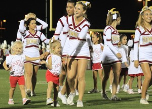 Little girls of all ages are being taught the principles of cheer by both the Varsity and Junior Varsity Lady Vikes through the Cheer Clinic program which performed during the Oct. 1 football game against Bell High School at Allen Lane Stadium. The young blonde twins stole the show that night with their enthusiasm about cheer and touching smiles.