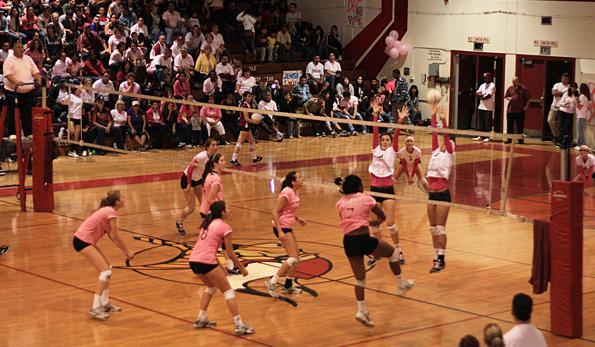 Girls volleyball thinks pink