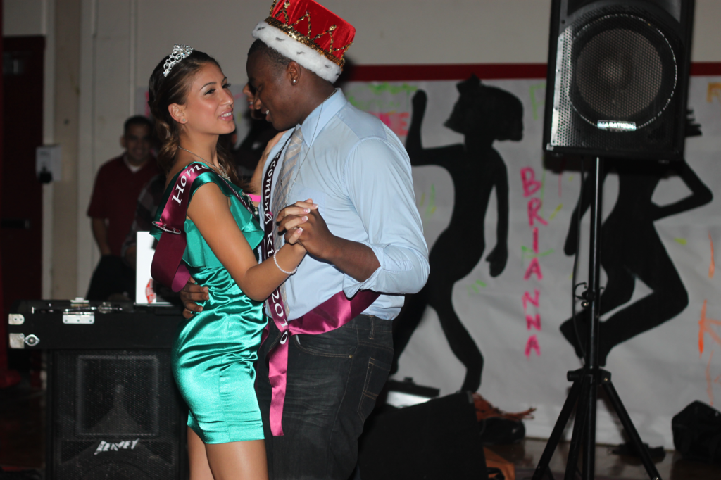 "At the Homecoming dance which was held on October 15 in the gym, the king and queen, Vincent Reynolds and Nicole Sanchez share a dance.  The Homecoming dance, themed ""City Night Lights"" began right after the game and lasted until midnight."