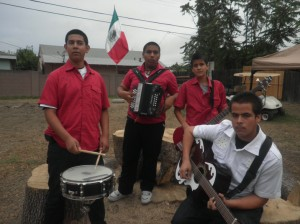 Grupo  Comandante practices on October 17 at Mario and Marco Arroyo's house for their next performence which would be on October 23. The boys practiced while family member watched and enjoyed the music coming from their backyard.