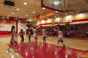 Girls basketball defeat Lancers in double over-time