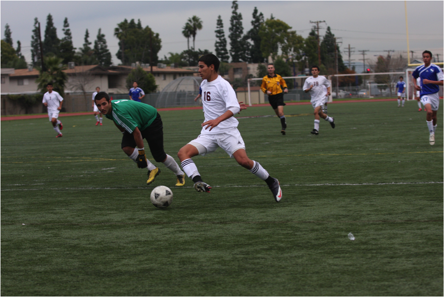 Running the ball past the goalie on Jan 12, Andrew Reveles, 16, sets up to score for the Vikings. Despite numerous close calls, the Vikings managed to keep the Gahr Gladiators at a 1-1 tie.
