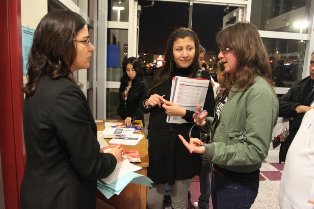 Senior students and parents inquisitively ask Representative Diana A. Porras about Free Applications for Federal Student Aid on Jan. 13.  Porras handed out grant applications that could lead their child to scholarships.