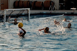 Preparing to block her rival against Bell Gardens, Janel Madrigal stops the competition from scoring at the Downey City Pool on Jan. 17.  Vikings conquered Bell Gardens with a final score of 11-7.