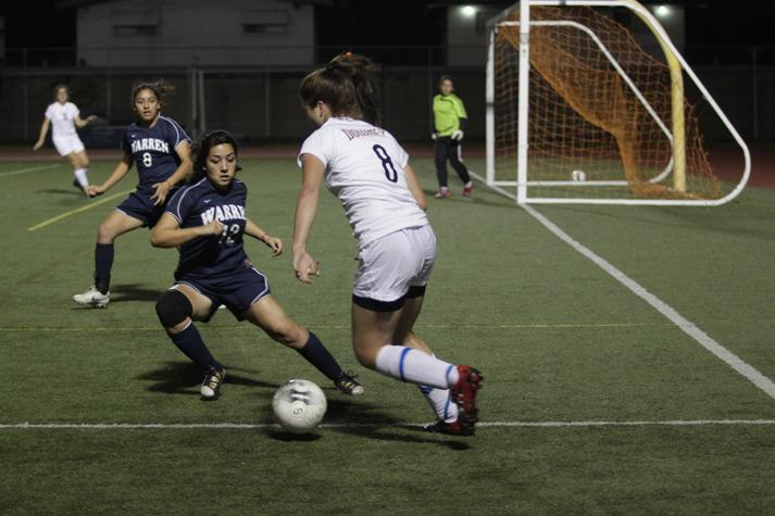 During the final game of the season on Feb. 9, Makayla Taylor focuses on getting past Warrens' defensive players at the Allen Layne Stadium. The Lady Vikes Varsity soccer team took home a win against the Warren Bears with a score of 4-2, which took them to the CIF finals.