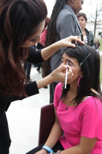 A student from Marinello Schools of Beauty applies make-up to Lizeth willing volunteer on Feb. 23. Marinello students gave free hairstyling, manicures, and make-up on campus as an act for the High School Outreach Program.