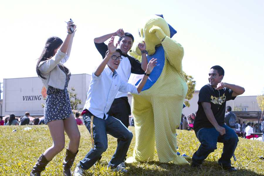 "At the Downey High Club Rush, Eduardo Munoz,11, disguised as a green and purple dinosaur, dances to ""YMCA"" with his fellow Juniors Yasmeen Delatorre, Rigoberto Chavez, Arnold Gonzalez, and Aaron Sanchez. ""It was really fun! I enjoyed the moment,"" Munoz stated. ""It was super hot and sweaty inside the dinosaur suit, but it was worth it."""