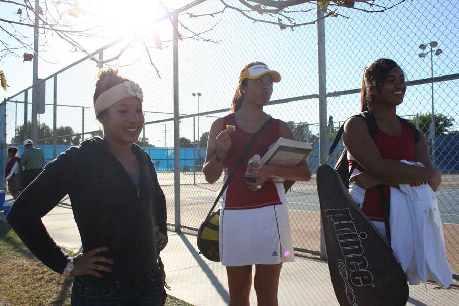 In a fight to try and win, a league title at Warren High school Oct. 24, with a match against Warren, are tennis players and seniors and junior Erin Freeman,11, left, Toni Salgado,12, middle, and Johanna Verga, 12, right.  Together these Vikings had fought hard to try and win for the first time in thirty years.