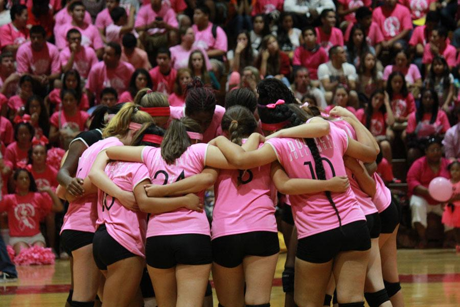 Moments before the beginning of the Downey vs. Warren Dig Pink volleyball game, on Sept. 27 in the gym, the Lady Vikes come together for their ritual huddle. Throughout the years, the team has been able to raise a total of $17,000 in support for finding a cure for breast cancer.