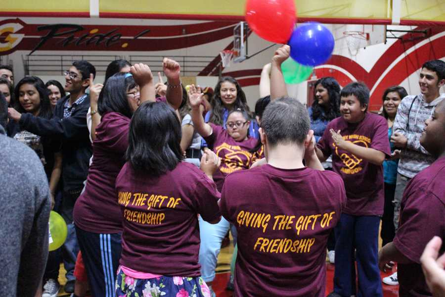 On October 25, Alicia Lopez, 9, dances at the DHS Amigos Club BBQ in the gym to meet and greet new members. Gathered around each other, club members danced, and played games with balloons to bond with new friends.