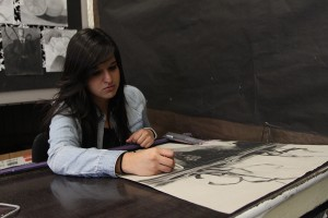 "In room Y-2, Adrianna Casas, 12 , shows her appreciation for art while working on her new piece for AP Studio Art, on Monday, October 22. ""My inspirations came from my older brother and my grandma,"" Casas said, ""I guess music inspired me as well."""
