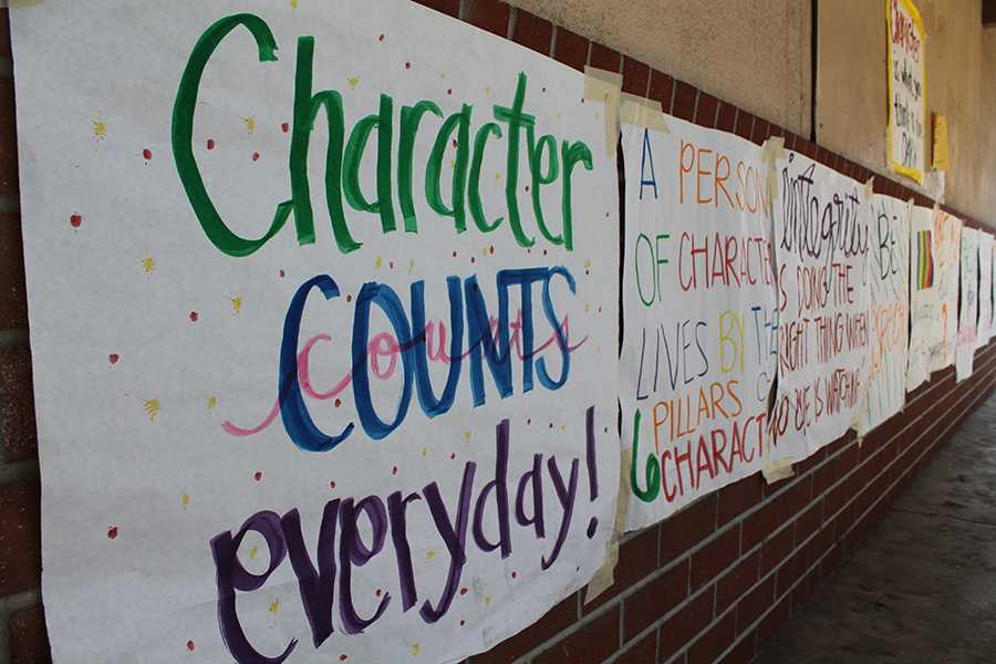 "Throughout the week of Oct. 15 to Oct. 19, Downey High School's ASB encourages students to display qualities of the six pillars of character, during Character Counts week, by plastering posters around campus.  ""It was hard to spread this around the student body, but even if it gets to one persons, it's enough,"" Jenifer Sicardi, 12, said."