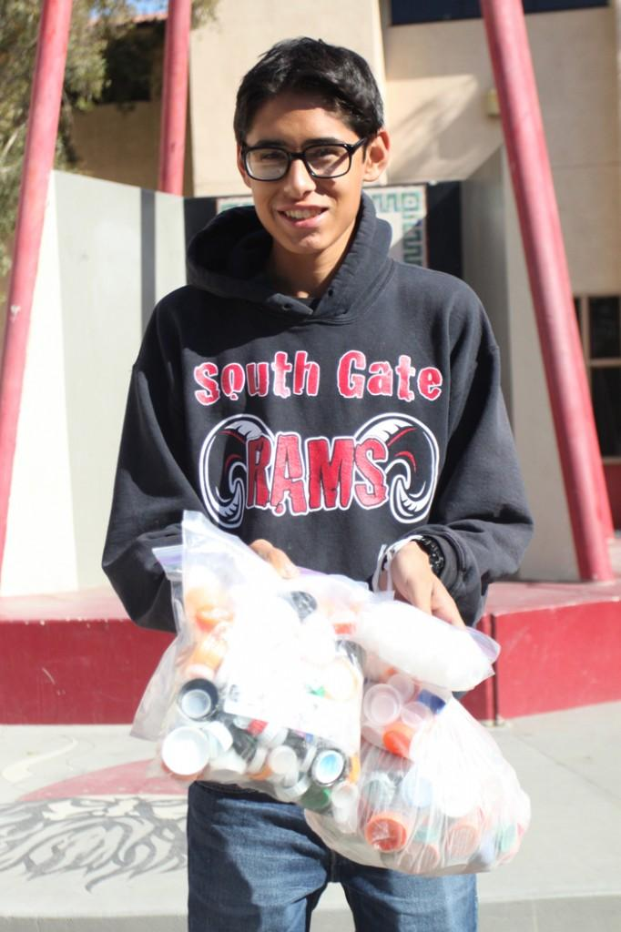 "Downey High School student, Rigoberto Chavez, 11, has been collecting bottle caps since mid September for his cousin who has cancer. ""Every thirty caps gets her a free chemo session,"" Chavez said."
