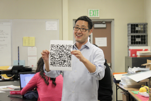 """During second period in the new Biomedical class, Mr. Hwang demonstrates how to find more information on the human body using a QR app. For students that have interest in becoming a doctor in the future, the new science class is offered in room X-2. """" It's a very fun and interesting class to teach,"""" Mr. Hwang said. """"I enjoy teaching it."""""""
