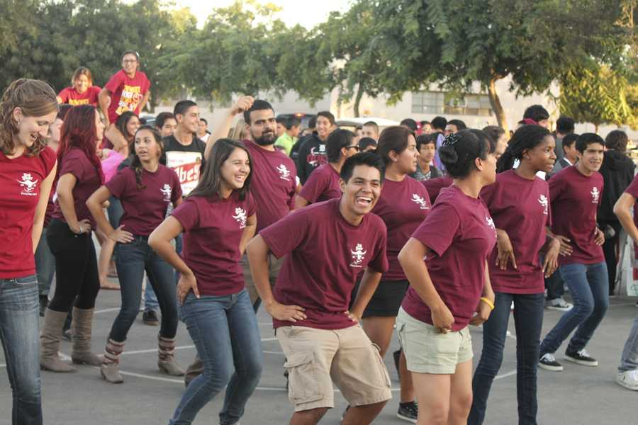 "The Viking Link organizes a freshman tailgate before the Downey vs. Oxnard football game at Allen Layne Stadium, on Sept. 21, that includes link leaders and link advisers Ms. James, Ariel Bravo, 12, Destiny Jones, 12, Mr. Armendariz, Mario Neblina, 12, Fabiola Anguiano, 12, Nkechi Okoroma, 11, and Cory Trujillo, 12. The night was filled with students dancing to various songs like the Cha Cha Slide, the Cupid Shuffle, and even the Macarena, which was a hit and got many students running for the dance floor. ""I thought it was fun because we got to interact with different people."" Neblina said. ""Normally with people we wouldn't interact with on our own."""