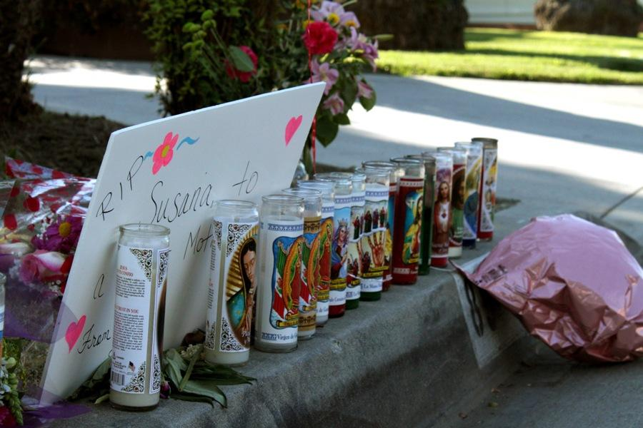 Candles, flowers and a poster are placed in front of the Cleta St. residence to pay tribute to Susana Perez, the mother who was killed, on Wednesday, Oct. 24. Suspect Jade Douglas is currently being held in suspicion of the crime.