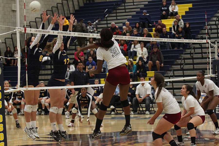 On Saturday, Nov. 10, Joy Miley, 12, helps the varsity volleyball team score against Los Osos High School, in Rancho Cucamonga, during their second round of CIF. The Vikings lost 0-3 and did not make it to the third round of CIF.