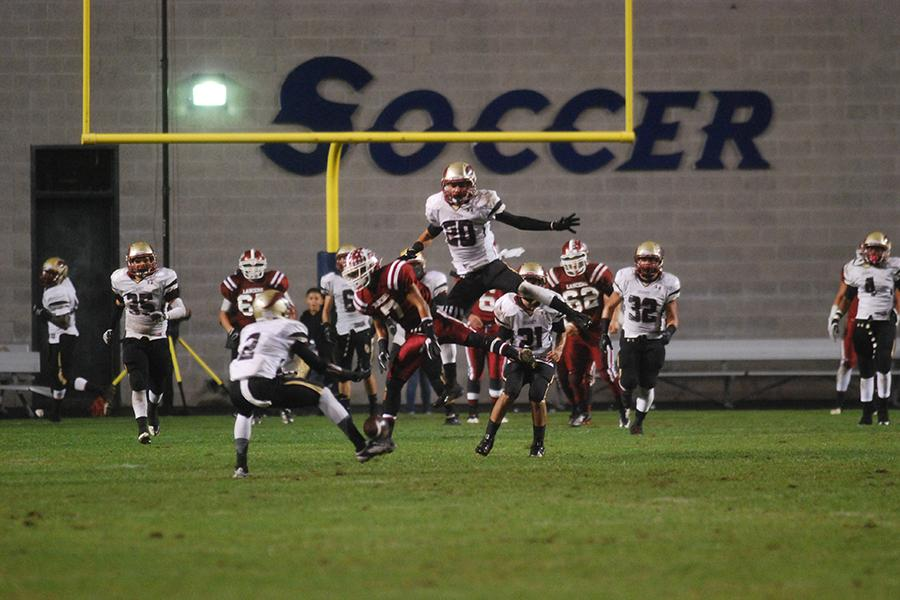 During the CIF Finals game against La Serna on Dec. 1, Tristan Esparza, 11, and Jason Thomas, 10, attempt to catch the ball to prevent La Serna from scoring a touchdown. The Vikings were successful in blocking the opposing team from scoring and won the game 33-25.