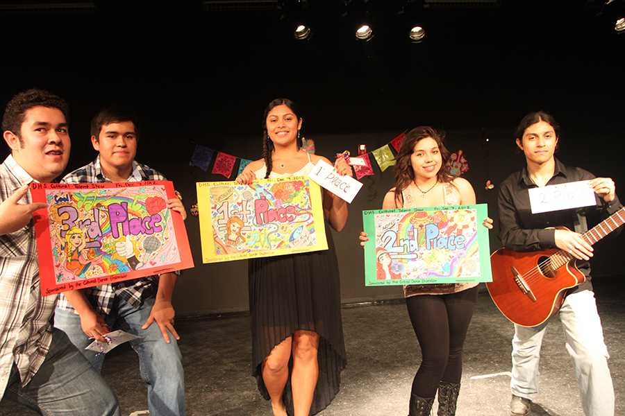 "On Friday, Dec. 7, Christopher Vazquez, 12, Nick Vazquez, 11, Angel Gonzales, 11, Sophie Loulakis, 10, and George Loulakis, 12, take first, second, and third place after singing in front of their friends and family at the Cultural Talent Show in the DHS theater. Gonzales sang Bruno Mars' song, ""If I Were Your Man."""