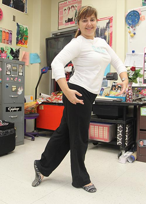 "Mrs.Macomber poses in fourth position of ballet in her classroom to show how she enjoys to express herself through the various forms of dance. ""I'm just inspired by the young generation,"" Mrs.Macomber said. ""The stuff that young dancers do today is amazing."""