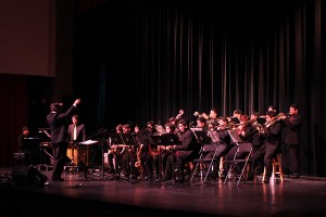 Under the direction of Mr. Olariu the Jazz Band performs at the Downey Civic Theater on, Dec. 12, for the Winter Concert put on by the music department. The Jazz Band drew cheers from family and friends with various Christmas songs and renditions.