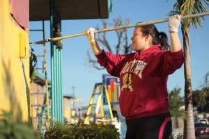 "On January 19, Jessica Samaniego, 11, helps paint Longfellow Elementary School for the Compton Initiative. ""I had lots of fun and just knowing that the work we did will make someone happy,"" Samaniego said, ""it makes me feel great about doing it."""