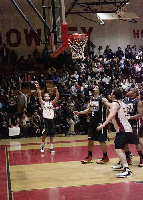 """On Tuesday, Jan. 8, Mr. Hobbensiefken scores against the Power 106 team during the basketball game to help fundraise money for Club Entourage in the DHS gym. The celebrity guest, Clyde Carson performed """"Slow Down,"""" during half time."""