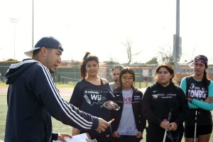 """During second period block, new coach for girl's lacrosse, Mr. Mires, gives a lecture to the team on the field, in order to see that they are doing well academically. """"If they cannot perform in class, then they cannot do their assignments on the field,"""" Mr. Mires said."""