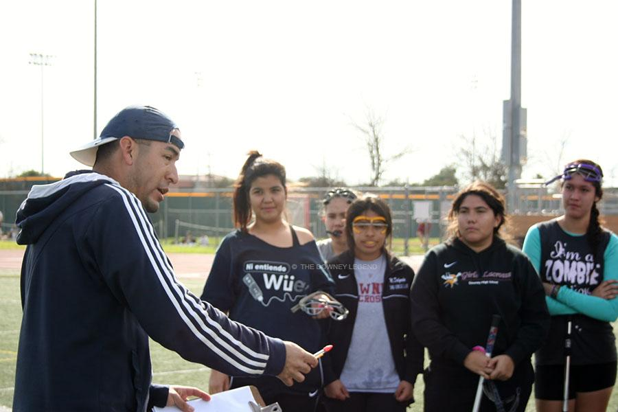 "During second period block, new coach for girl's lacrosse, Mr. Mires, gives a lecture to the team on the field, in order to see that they are doing well academically. ""If they cannot perform in class, then they cannot do their assignments on the field,"" Mr. Mires said."