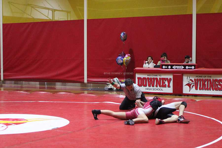 In the Downey High gym during a match against Domingez wrestler, Maria Hernadez,11, attempts to pin her opponent on, Jan. 24, in order to win her match. Hernadez is the sole girl on the wrestling team this year.