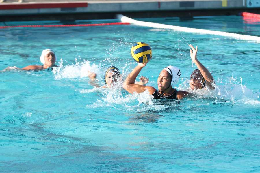 On January 10, 2013, at the Downey vs. Warren water polo game, Brenda Oporto, 12, passes the ball to her teammate in attempts to score again. The final score resulted in a loss of 7-4