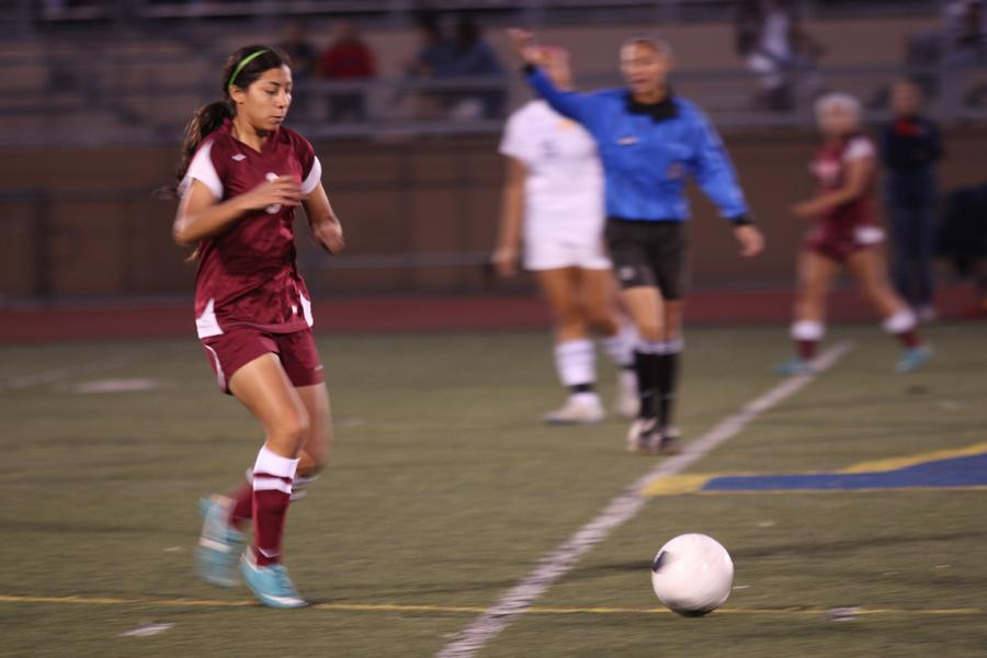 At the Downey vs. Warren game on Jan.8, Maritza Acuna,11, goes for the ball before her opponent. Downey scored 1-0 in the second half of the game.