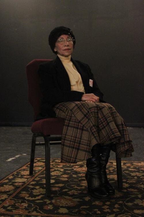 "On Feb. 21, guest speaker, Esperanza, waits in the theatre to discuss her father's survival during the Holocaust.  ""My father helped the Jewish people change their names, because he too had 10 passports with multiple names,"" Esperanza said."