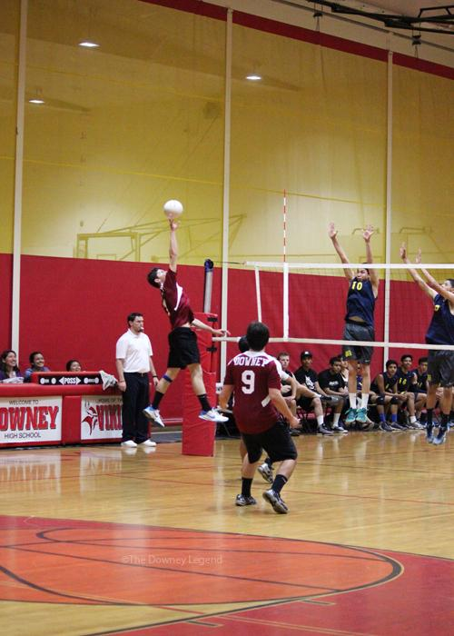"On March 21 Juan Radogal, 12, reaches the ball, spiking it to the other side scoring a point against rivals Warren. ""The most intense games are when we play against Warren,"" Radogal said. ""because we never want the Bears to win."""