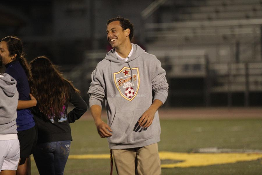 After winning the first round in state playoffs, assistant coach, Brandon Hitchcock, celebrates with the soccer team on Tuesday, March 5 in the Allen Layne Stadium.