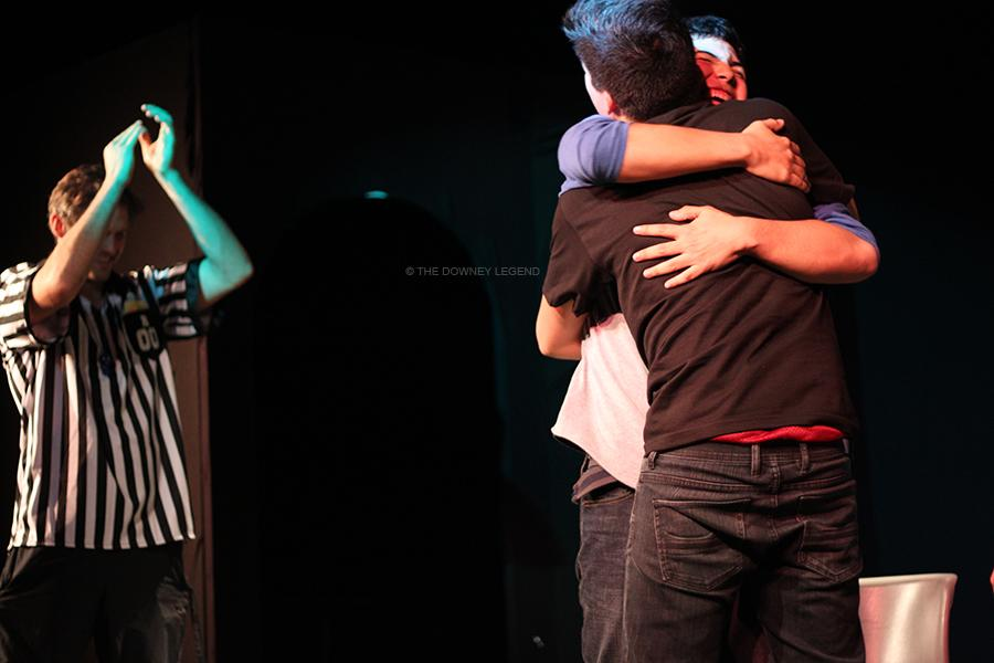 On March 29, Bryce Caliwag, 12, and Marco Arroyo, 11, share a hug after Caliwag successfully figured out what Arroyo was portraying in a skit about speed dating in the DHS theatre. Later that night, Caliwag and Arroyo's team won five points in this round versus the Red Team.