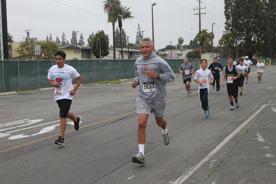 At the 5K for TLC , ASB director, Gordon Weisenburger  runs his first lap around the corner of Harriman St. on April 13. ASB students also participated with Weisenburger.