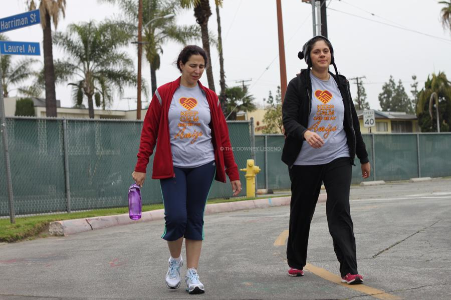 During the 5K for TLC Amber Geldien walks past Laurel Av with librarian Natalie Flores on April 13.  They attended with the 5K with their club DHS Amigos.