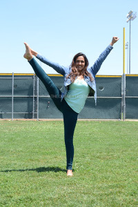 On Friday, May 24 junior Amanda Azurduy rehearses her routine before auditioning in front of the judges to become part of the 2013-2014 cheer team. The upcoming cheerleaders learned routines from May 20-23 and showed their potential to judges on May 24.