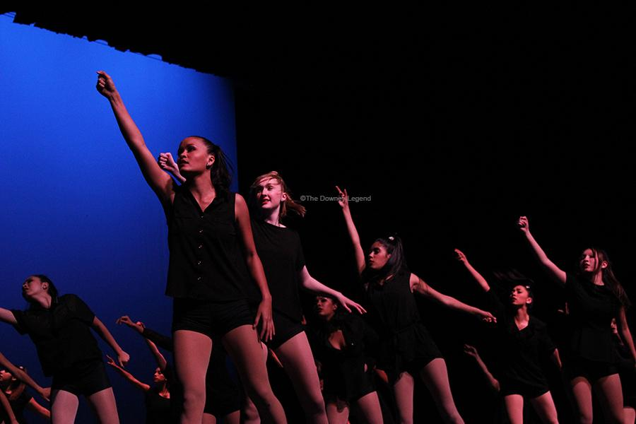 "At the Downey Civic Theater, the dance team performs ""Little Talks,"" on Wednesday, May 8, which was choreographed by Downey High alumnus Adriana Castrejon, on Wednesday, May 8, 2013. The team participated in one of several dances as part of the Dance Review, which showcased the talents of dance teams across campus."