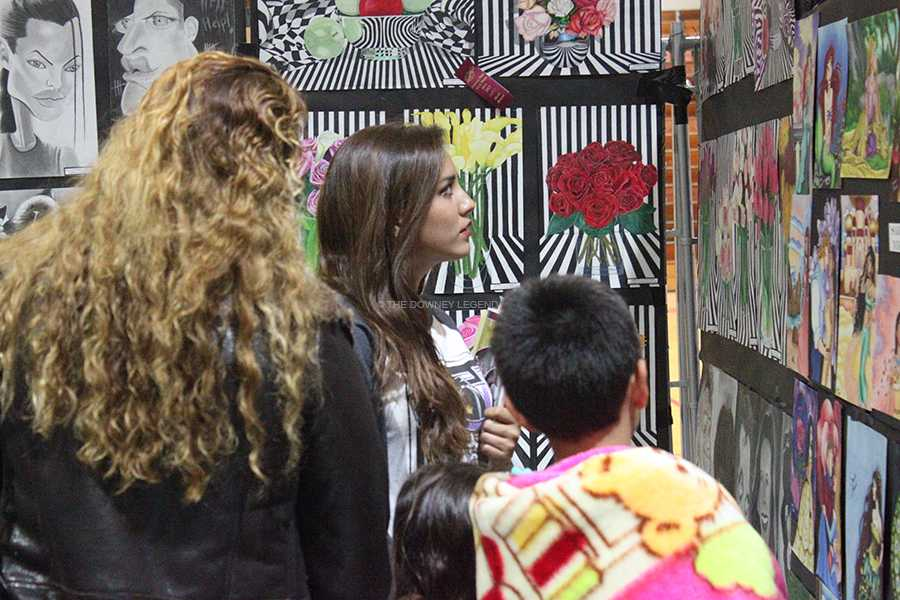 During Open House, students and parents arrive to the gym for the art show to see all the work done by students.