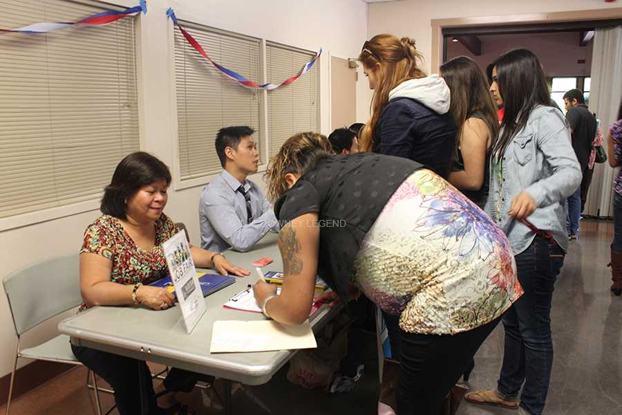On April 25 at the Lakewood Youth Center, insurance job scout Mia Xilo finds potential employees for her company. There were 12 different job locations available to apply for at the event.