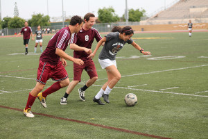On May 9,during the CIF Champions vs. the Faculty, Mr. Glasser lifts his shirt and runs with excitement after scoring a penalty kick. With Glasser's goal, he helped his team get one step closer to win