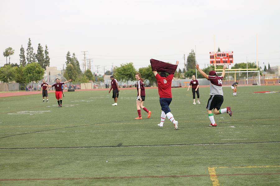 On May 9, during the CIF champions vs. the faculty, Mr. Glasser lifts his shirt and runs with excitement after scoring a penalty kick. With Glasser's goal, he helped his team get one step closer to win.