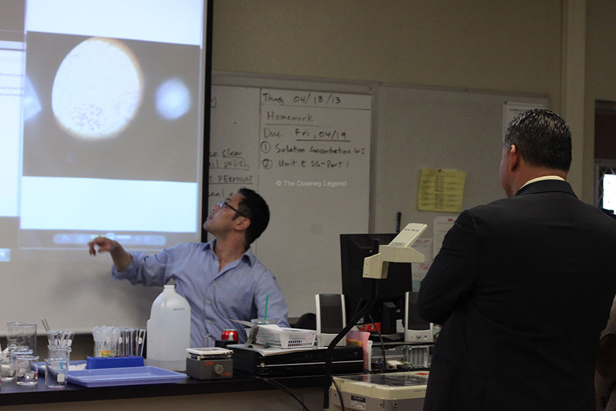 "On April 18, Mr. John Hwang shows Superintendent, Dr. John Garcia, pictures students took of their chromosome spreads from their latest textbook unit. ""This is excellent preparation for students interested in going into the bio-science field,"" Dr. Garcia said."