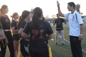 On Friday, May 10, at the Allen Layne Stadium, Jeremy Villa, one of the coaches for the senior girls, explains what they have to do in order to beat the juniors in the Powder Puff game. Later that night, the score ended at 18-13, where the juniors achieved victory.