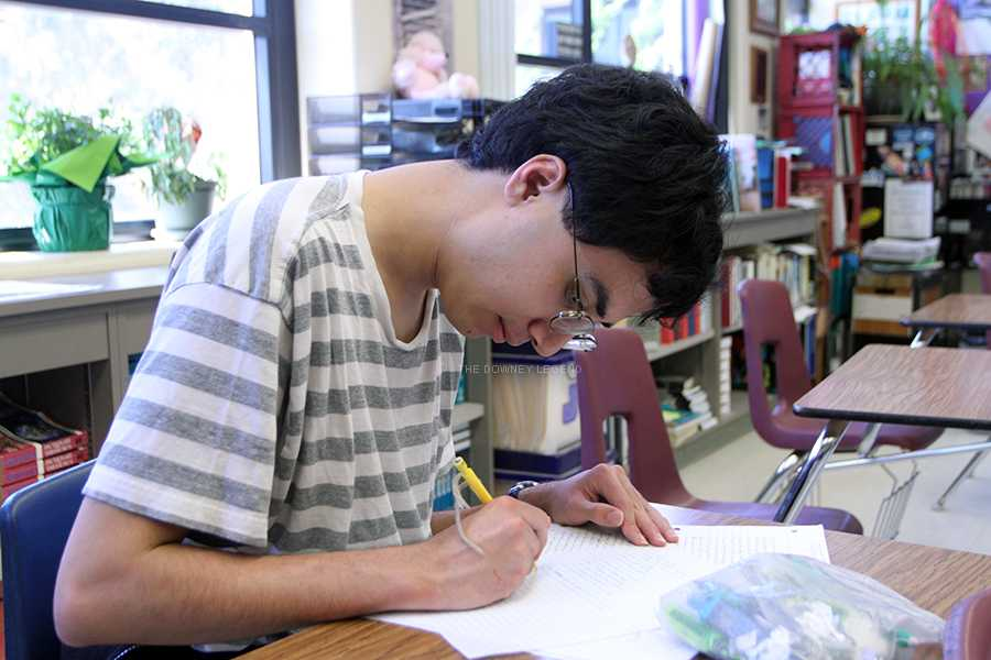 In the comfort of his A.P. English class senior Philip Shimada resumes work on a piece of poetry for his own enjoyment, May 28. Shimada is known among his classmates for composing beautiful poetic lines that leave many speechless.