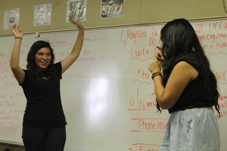Performing a skit as a photographer in bungalow T-1, junior, Alexiz Hernandez, pretends to snap pictures of sophomore Frida Munoz, as part of their audition for becoming a Comedy Sportz member on Wednesday, Sept. 25. Munoz received a callback, but did not become part of the Comedy Sportz team.