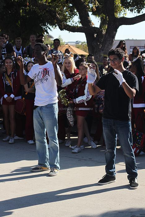 While conducting the marching band at the pep rally, drum major Kevin Valencia, 12, keeps time while Jeremy Moore, 11, imitates his every move. Unlike other years this year, the assembly was held in front of the ASB window.